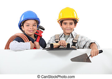 Children dressed as tradesman with a board left blank for your message