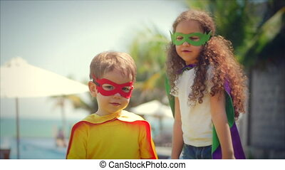 Children Dressed in Superhero Costumes, Cloaks and Masks...