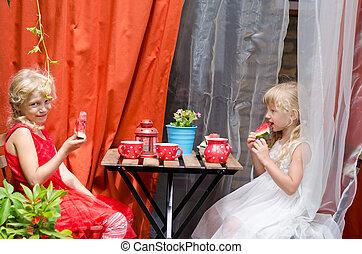 children drinking tea