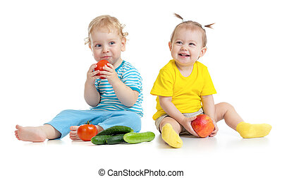 Children eating fruits and vegetables isolated