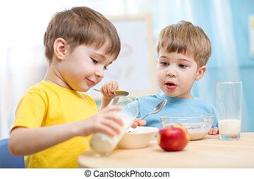 children eating healthy food indoors