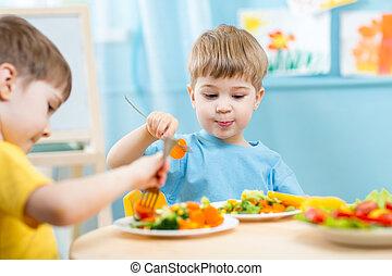 children eating in kindergarten