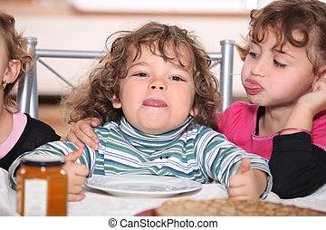 Children eating pancakes