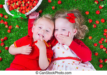 Children eating strawberry