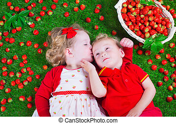 Children eating strawberry - Child eating strawberry. Little...