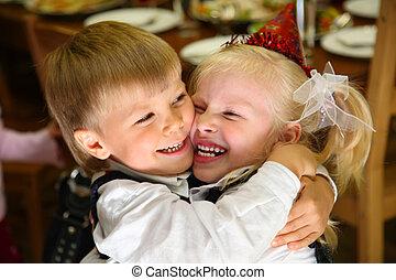 Children embrace on holiday in kindergarten