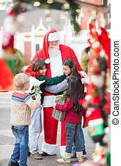 Children Embracing Santa Claus - Children embracing Santa ...