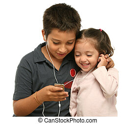 Children enjoying a mp4 player together - Brother and sister...