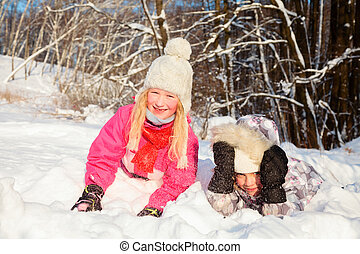 Children enjoying a wintertime