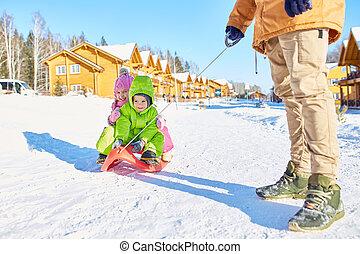 Children enjoying sleigh ride