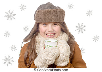 children fashion girl with fur winter coat and cup of tea