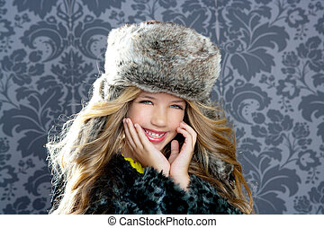 children fashion girl with winter leopard coat and fur hat