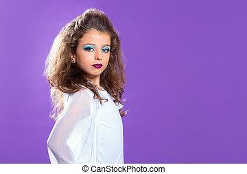 Children fashion makeup kid girl on purple