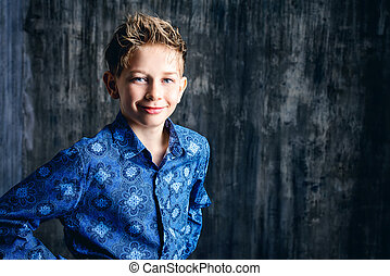children fashion - Smiling teen boy over grunge background....