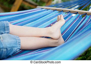 children feet in the hammock