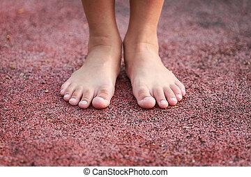 Children feet in the park