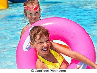 Children female swimming in pool.