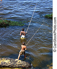 Children fishing in sea