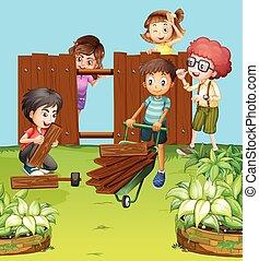 Children fixing fence in the garden