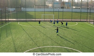 Children footballers playing soccer match outdoor - Drone ...