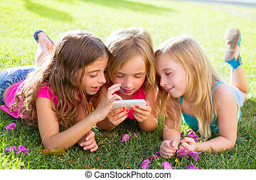 children friend girls playing internet with smartphone -...