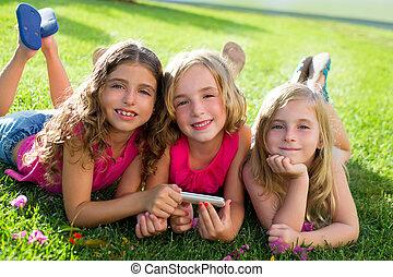 children friend girls playing internet with smartphone -...