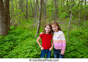 children friend girls playing on the jungle park forest