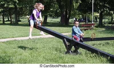 children fun on seesaw