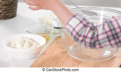 Children girl hands pointed on glass bowls with ingredients...