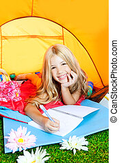 Children girl writing notebook in camping tent with flowers