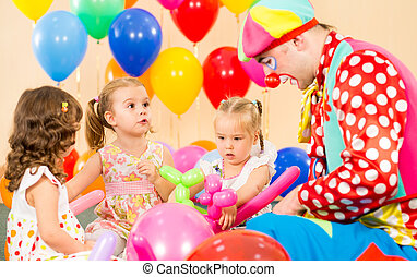 children girls and clown on birthday party