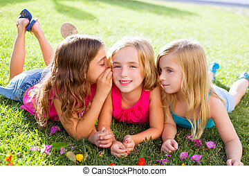 children girls playing whispering on flowers grass -...