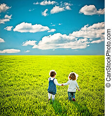 Children going on summer field - Rear view for two children ...