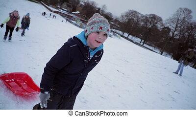 Children Going Sledding in the Park