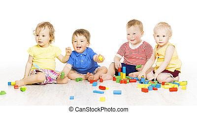Children group playing toy blocks. Baby Kids development