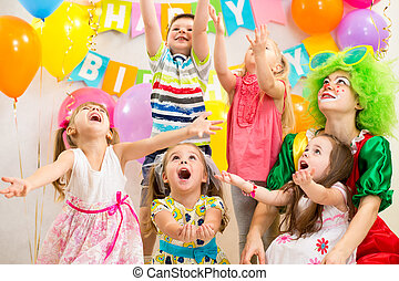 children group with clown celebrating  birthday party