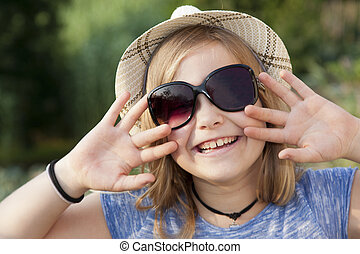 children - grunge girl portrait with hat and sunglasses
