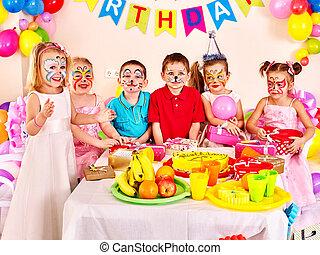 Children happy birthday party eating.