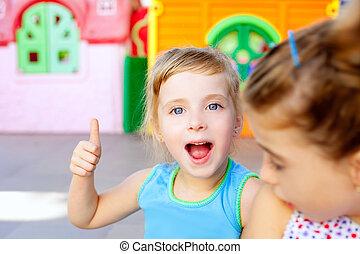 children happy little sister girls with ok gesture