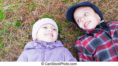 children happy smile brother sister lay ground