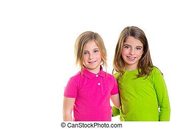 children happy two sister girls smiling hug together