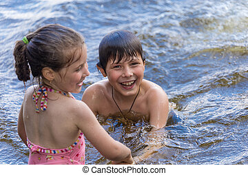 Children have fun in a lake