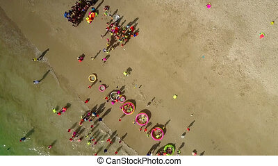 children have rest entertaining on beach with educators -...
