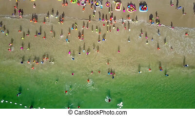 children have rest running from rolling wave to beach -...