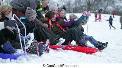 Children Having a Sled Race