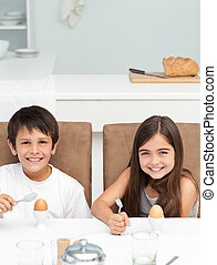 Children having breakfast in the kitchen