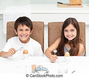 Children having breakfast in the kitchen