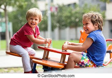 Children having fun at playground - Happy excited children...
