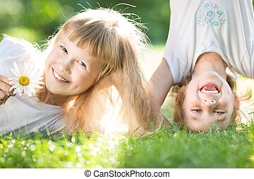 Happy children playing outdoors in spring park