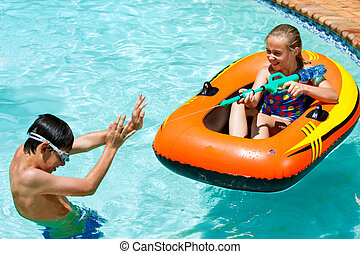 Children having fun in pool.